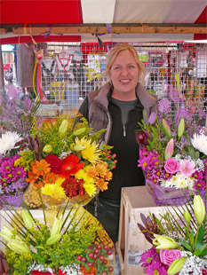 Market trader Zoe Smith selling fresh flowers from Tuesday's to Saturday's