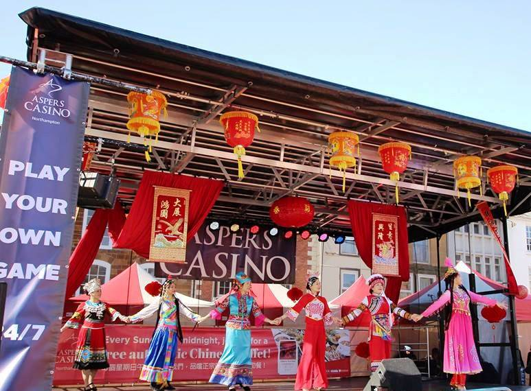 Performers on stage at Chinese New Year event.