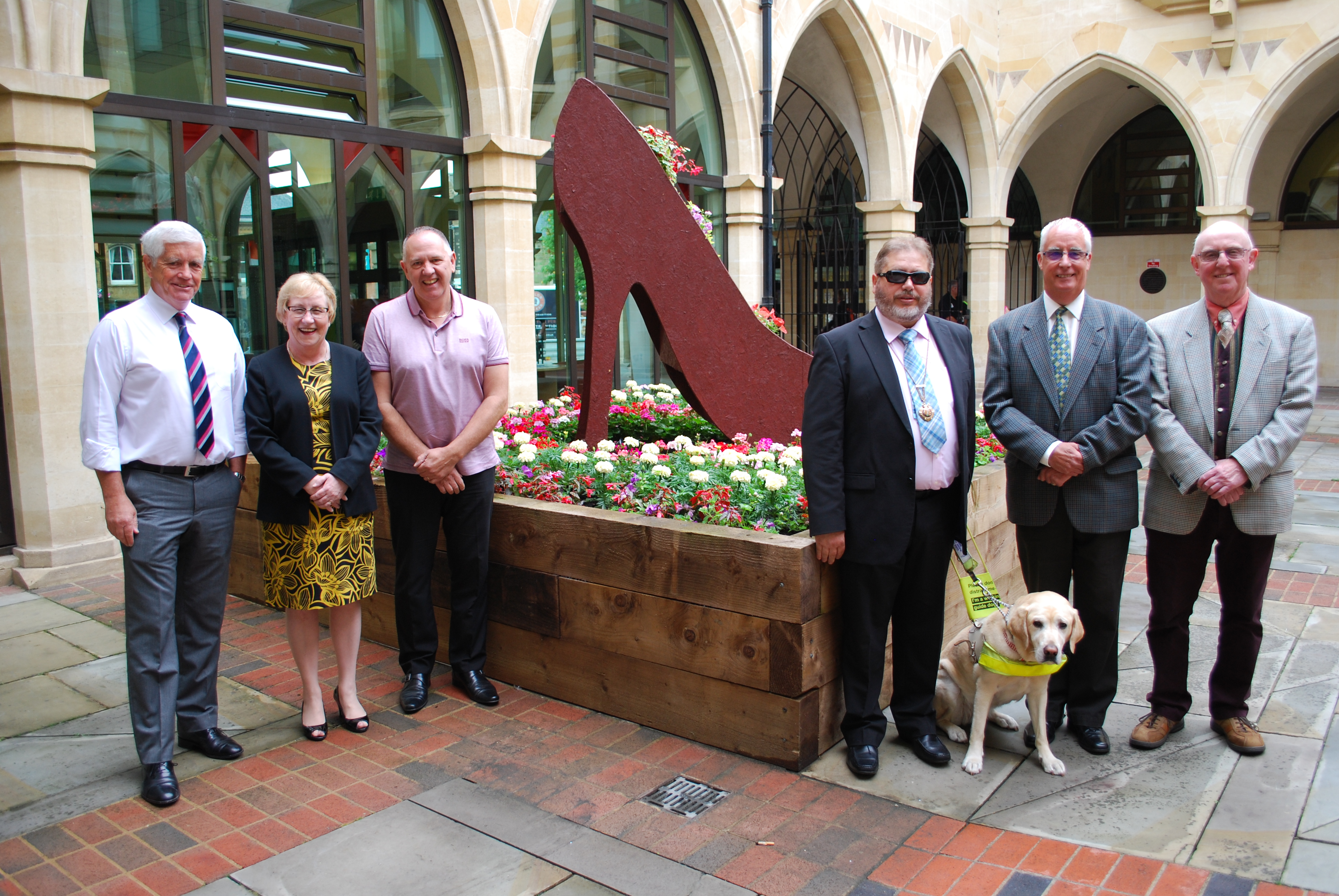 Councillors and judges by The Guildhall floral shoe display