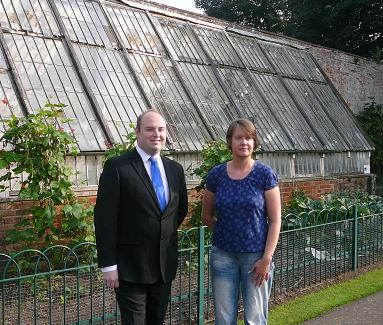 Councillor David Mackintosh and Nicola Hedges in front of the Victorian greenhouse