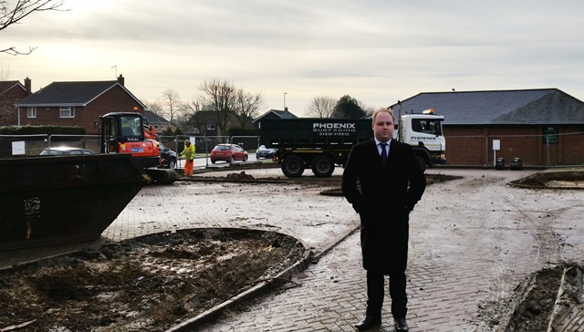 Councillor David Mackintosh at the improved community car park in Ecton Brook