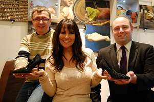 Linda Lusardi donating shoes to Northampton Museum and Art Gallery
