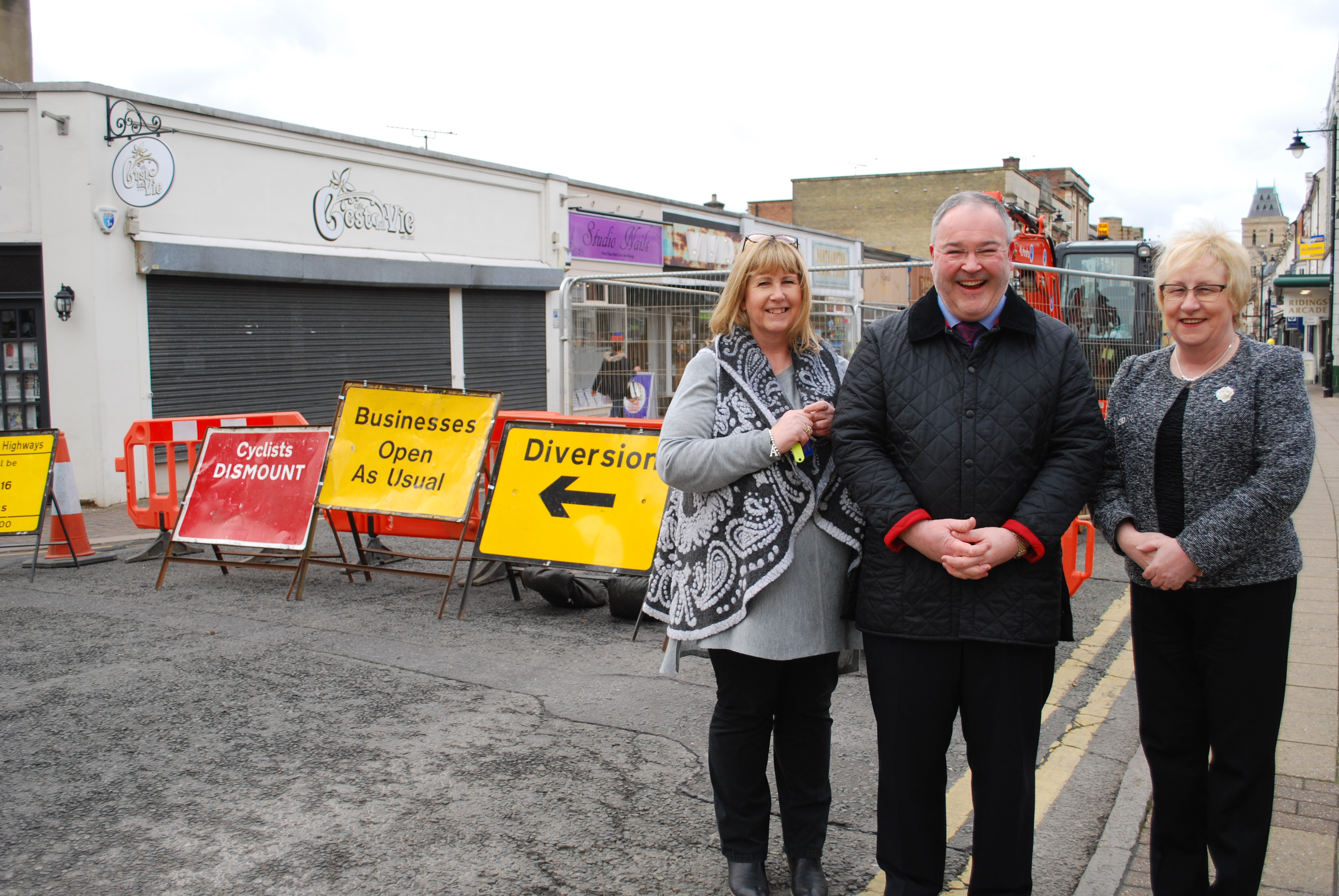 Cllr Mary Markham with Annie Rockley from Peppertrees and Jonathan Williams from Montague Jeffrey on St Giles Street.